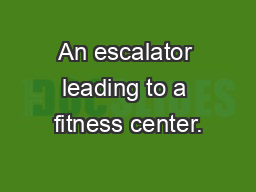 An escalator leading to a fitness center.
